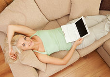 Woman lying on sofa Royalty Free Stock Photos