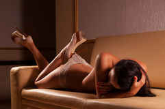 Woman lying on the sofa Royalty Free Stock Photography