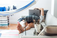 Woman Lying on Sofa With Cat in Her Foot stock photos