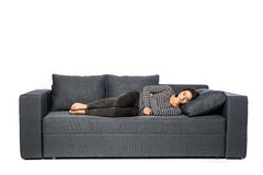 Woman lying on sofa looking sick Royalty Free Stock Photos