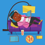 Woman lying on sofa with many gadgets. Stock Image