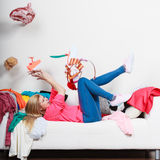 Woman lying on sofa, pelted clothes Royalty Free Stock Images