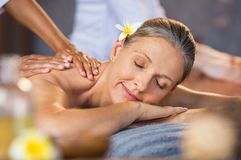 Woman receiving massage at spa stock photography