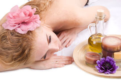 Woman lying with spa products Royalty Free Stock Photo