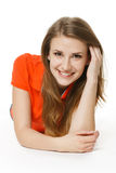 Woman lying on the studio floor smiling at you Royalty Free Stock Images