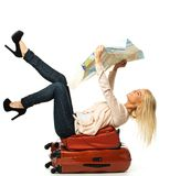 Woman lying on a suitcase Royalty Free Stock Photos