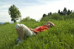 Woman lying in summer field Stock Photo