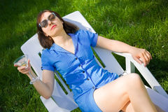 Woman lying on the sun lounger Royalty Free Stock Photos