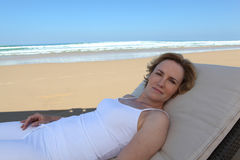 Woman lying on sun lounger Royalty Free Stock Photography