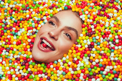 Woman lying on sweets Stock Photos