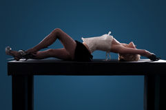 Woman lying on the table Royalty Free Stock Images