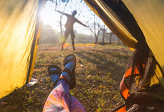 Woman lying in a tent with coffee ,view of mountains and sky Royalty Free Stock Photos