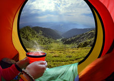 Woman lying in a tent with coffee Royalty Free Stock Photo