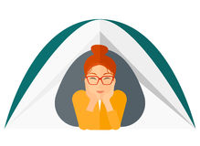 Woman lying in tent Stock Images