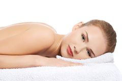 Woman lying on towel ready to massage Stock Photos