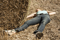 Woman lying unconscious in the field Stock Photos