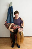 The woman is lying upside down on man's knees Stock Photo
