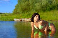 Woman lying in water Royalty Free Stock Photography