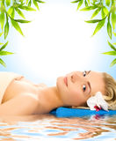 Woman lying in water Royalty Free Stock Image