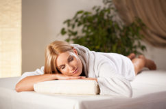 Woman lying in wellness center Stock Photography