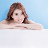 Woman lying on white table Royalty Free Stock Photos