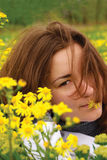 Woman lying  in a yellow flowers Royalty Free Stock Photos