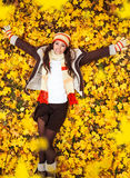 Woman lying on yellow leaves Royalty Free Stock Photo