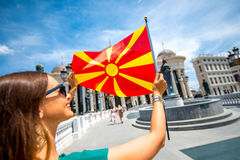 Woman with macedonian flag in Skopje city center Stock Photos