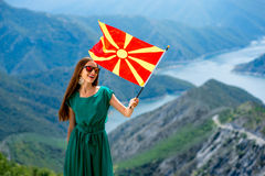 Woman with macedonian flag on the top of mountain Stock Images