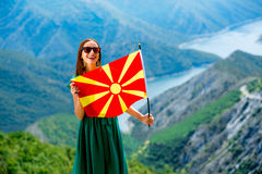 Woman with macedonian flag on the top of mountain Royalty Free Stock Photo