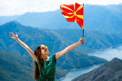 Woman with macedonian flag on the top of mountain Stock Photography