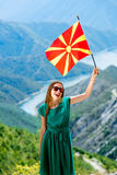 Woman with macedonian flag on the top of mountain Royalty Free Stock Images