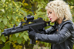 Woman with machine gun Stock Photography