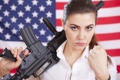 Woman with machine gun threatening Royalty Free Stock Photo