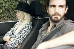 Woman mad at man in car after a fight Royalty Free Stock Image
