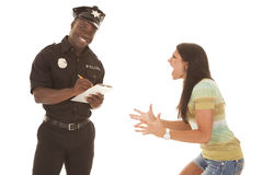 Woman mad at policeman. A women yelling and screaming at a policeman, and the policeman is smiling stock photos