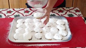 Woman made buns on the table stock footage