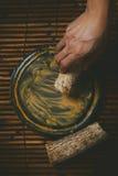 Woman made Thanaka powder Stock Photography