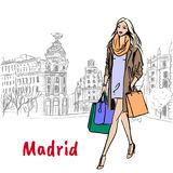 Woman in Madrid. Woman walking with shopping bags in Madrid, Spain. Hand-drawn illustration. Fashion sketch Royalty Free Stock Photo