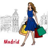 Woman in Madrid. Woman walking in Madrid, Spain. Hand-drawn illustration. Fashion sketch Stock Photography