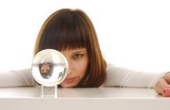Woman and magic ball. Young woman in white dress near glass magic ball Stock Photos