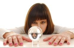 Woman and magic ball. Young woman in white dress near glass magic ball Royalty Free Stock Images