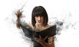 Woman with a magic book. Evil woman casts a black magic book. witch with a book on white background Royalty Free Stock Photos