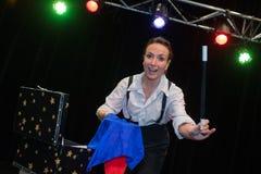 Woman magician doing tricks Royalty Free Stock Image