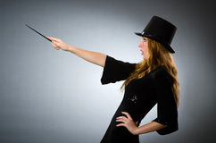 Woman magician doing her tricks Royalty Free Stock Image