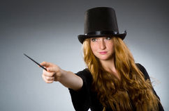 Woman magician doing her tricks Stock Photo