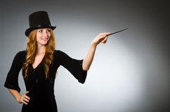 Woman magician doing her tricks Stock Photography