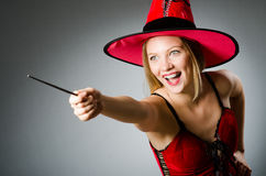 Woman magician doing her tricks Stock Image