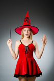 Woman magician doing her tricks Royalty Free Stock Photo