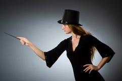 Woman magician doing her tricks Stock Photos